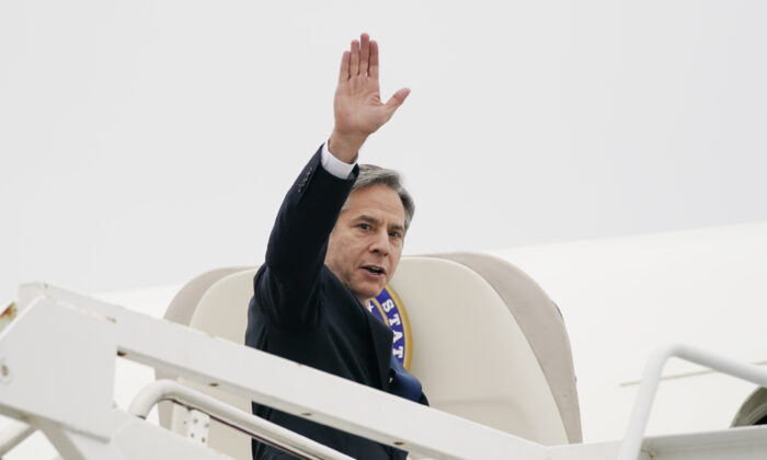 Secretary of State Antony Blinken waves as he departs for the Middle East from Andrews Air Force Base, Md., on May 24, 2021. (Alex Brandon/Pool/AP Photo)