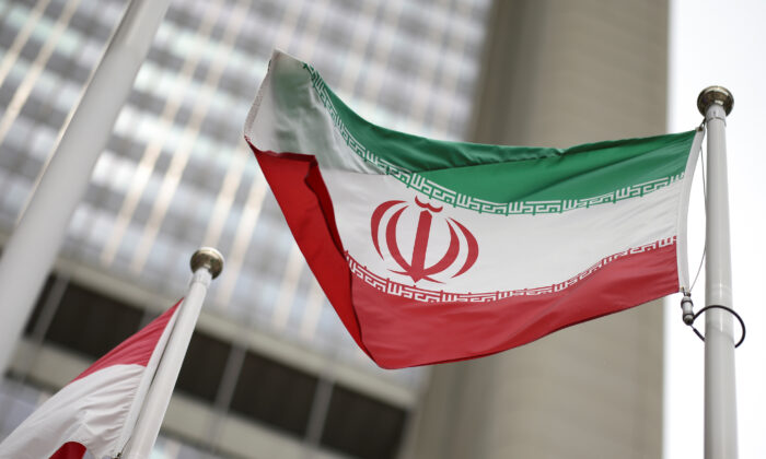 Iranian flag flies in front of the UN office building, housing IAEA headquarters, amid COVID-19 pandemic, in Vienna, Austria, May 24, 2021. (Reuters/Lisi Niesner)