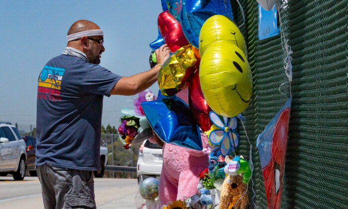 Local residents place items along the Walnut Avenue overpass bridge over the 55 Freeway in Orange, Calif., on May 24, 2021. (John Fredricks/The Epoch Times)