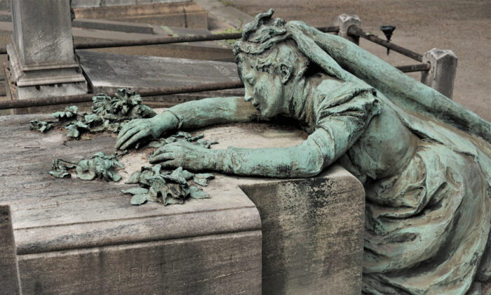 """A.E. Housman's poem """"With Rue My Heart Is Laden"""" expresses the sorrow of lost youth. Sculpture in Milan, Italy's Monumental Cemetery. (Alicja Graczyk/Shutterstock)"""