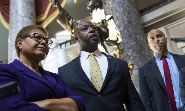 (L-R) Rep. Karen Bass (D-Calif.), Sen. Tim Scott (R-S.C.), and Sen. Cory Booker (D-N.J.) speak to reporters on Capitol Hill, in Washington, on May 18, 2021. (Drew Angerer/Getty Images)