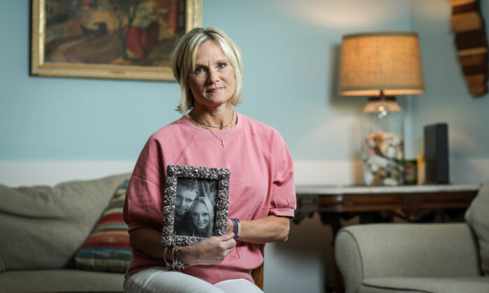 Michele Holbrook holds a photo of her son, Chandler Cook, who died of an overdose, at her home in Fernandina Beach, Fla., on May 19, 2021. (Samira Bouaou/The Epoch Times)
