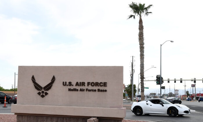 A sign near the main gate of Nellis Air Force Base in Las Vegas, Nev., is shown on April 3, 2020. (Ethan Miller/Getty Images)