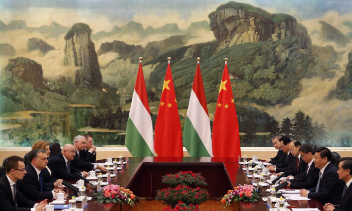 Hungary PM Viktor Orban (2nd L) and Chinese leader Xi Jinping (2nd R) lead their delegations in a meeting at the Great Hall of the People in Beijing on Feb. 13, 2014. (Rolex Dela Pena/AFP via Getty Images)