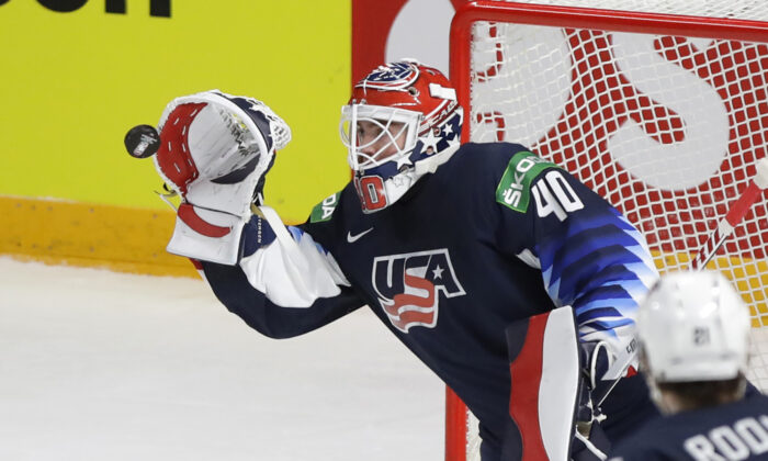 Goaltenders Cal Petersen of the United States makes a save during the Ice Hockey World Championship group B match between United States and Kazakhstan at the Arena in Riga, Latvia on May 25, 2021. (Sergei Grits/AP Photo)