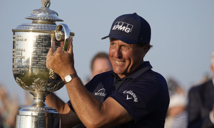 Phil Mickelson holds the Wanamaker Trophy after winning the PGA Championship golf tournament on the Ocean Course in Kiawah Island, S.C., on May 23, 2021. (David J. Phillip/AP Photo)