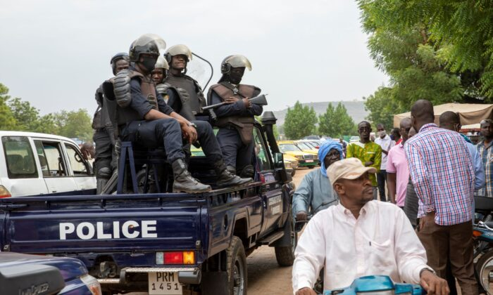 Malian police gather outside the Bourse du Travail where striking workers gathered to protest the arrest of President Bah N'Daw and Prime Minister Moctar Ouane by military personnel in Bamako, Mali, on May 25, 2021. (AP Photo)