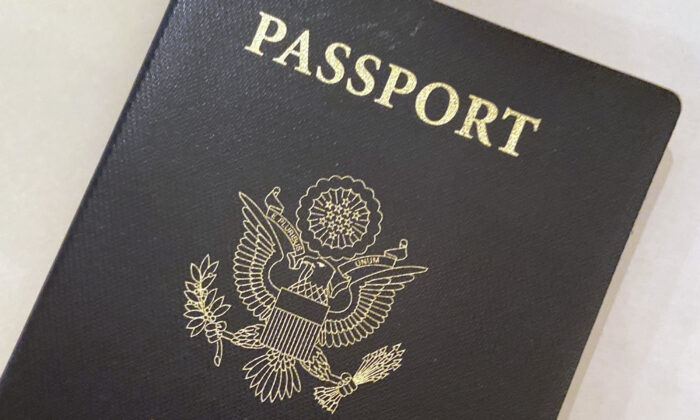 A U.S. Passport cover in Washington. The Biden administration says American citizens holding recently expired U.S. passports will be allowed to return home from abroad on that document until the end of year. (AP Photo/Eileen Putman)