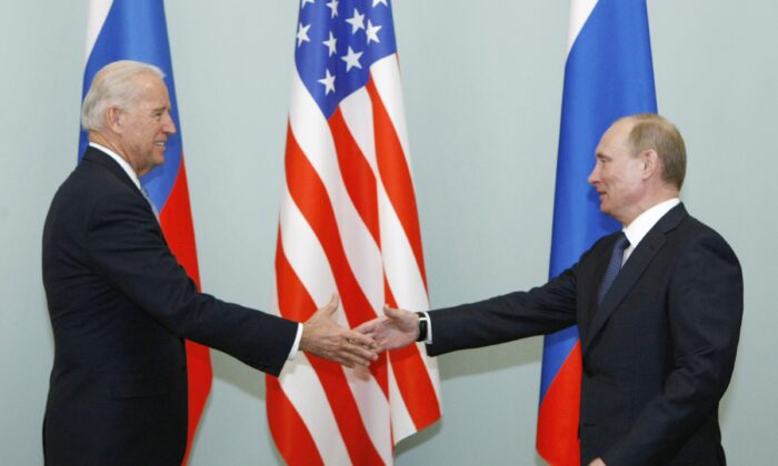 Then-Vice President Joe Biden (L) shakes hands with then-Russian Prime Minister Vladimir Putin in Moscow on March 10, 2011. The pair are set to meet in Geneva in June 2021. (Alexander Zemlianichenko/AP Photo)