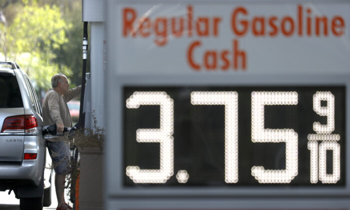 A customer at a 76 gas station in San Anselmo, Calif., on March 3, 2021. (Justin Sullivan/Getty Images)