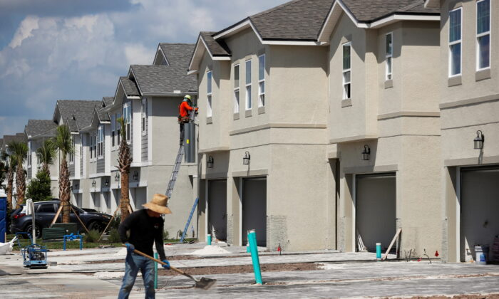 A carpenter works on building new townhomes that are still under construction while building material supplies are in high demand in Tampa, Fla., on May 5, 2021. (Octavio Jones/Reuters)