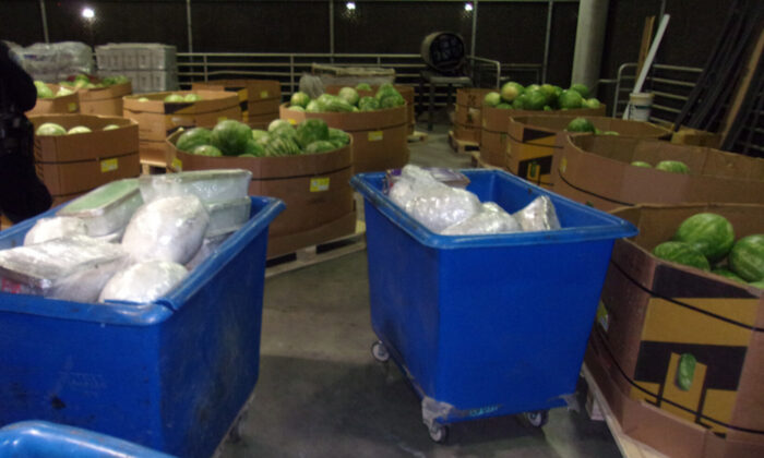 Plastic containers containing packages of methamphetamine are seized at Otay Mesa Commercial Facility in San Diego County, Calif., on May 18, 2021. (Courtesy of U.S. Customs and Border Protection)