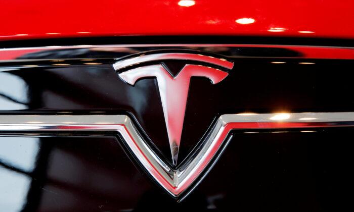 A Tesla logo on a Model S is photographed inside of a Tesla dealership in New York, on April 29, 2016. (Lucas Jackson/Reuters)