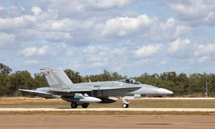 A No. 75 Squadron F/A-18A Hornet, tail number A21-011, departs on a sortie out of RAAF Base Tindal, in the Northern Territory, during Exercise Black Dagger 21-1 on May 4, 2021 (CPL Nicci Freeman/ADF)