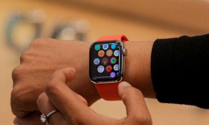 An Apple Store employee shows the Series 5 Apple Watch during the preview of the redesigned and reimagined Apple Fifth Avenue store in New York on Sept. 19, 2019. (Brendan McDermid/Reuters File Photo)