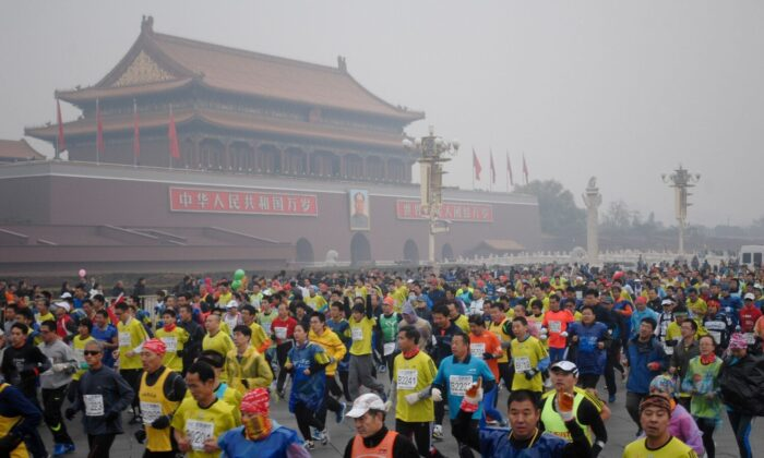 Runners take part in the 34th Beijing International Marathon, which began at Tiananmen Square in Beijing, China, on Oct. 19, 2014. (AFP/Getty Images)