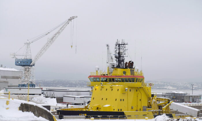 A ship sits in drydock at the Davie shipyard in Levis, Quebec, Canada, on Dec. 14, 2018. (Jacques Boissinot/The Canadian Press)