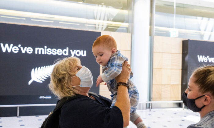 Woman hugs her grandson who she meets for the first time  at Sydney International Airport as NZ-Australia travel bubble opens on April 19, 2021 in Sydney, Australia. (Jenny Evans/Getty Images)