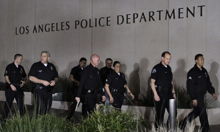 Los Angeles police officials arrive for a media briefing outside the police administration headquarters in this file photo. (Jonathan Alcorn/Getty Images)