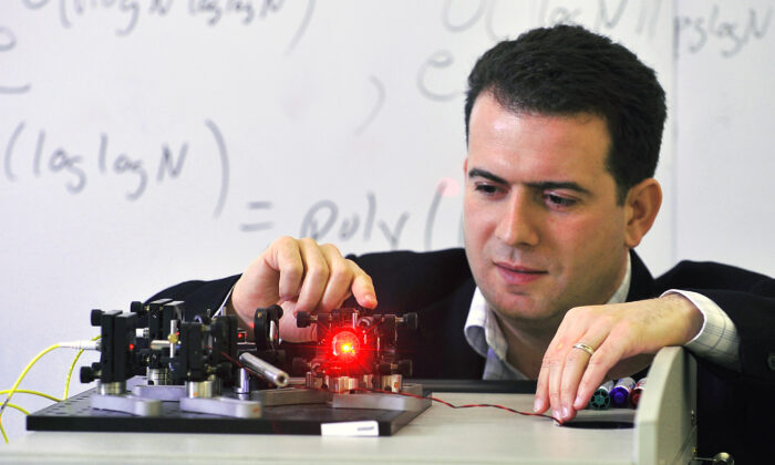 University of Waterloo quantum computing researcher Michele Mosca demonstrates a Mach-Zender interferometer. (Institute for Quantum Computing)