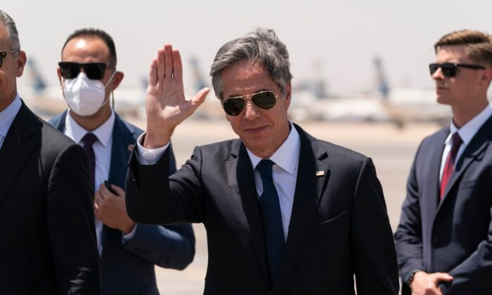 Secretary of State Antony Blinken waves as he steps off his plane upon arrival at Cairo International Airport, in Cairo, Egypt, on May 26, 2021. (Alex Brandon/Pool/AP Photo)