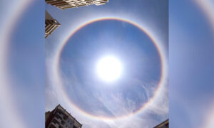 Skywatchers Witness Breathtaking Rainbow Halo Around the Sun Over City in Southern India