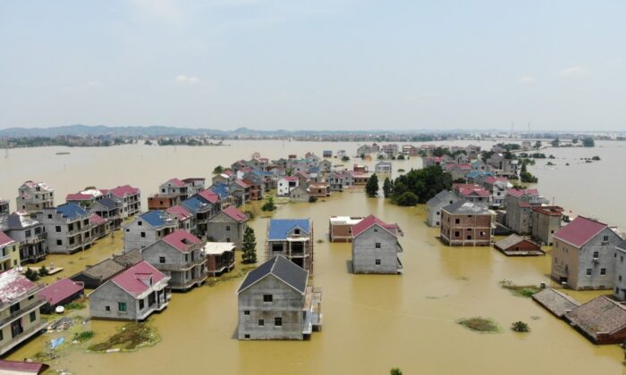 Buildings and farmlands are seen partially submerged in floodwaters following heavy rainfall in Poyang county of Jiangxi province, China, on July 17, 2020. (China Daily via Reuters)