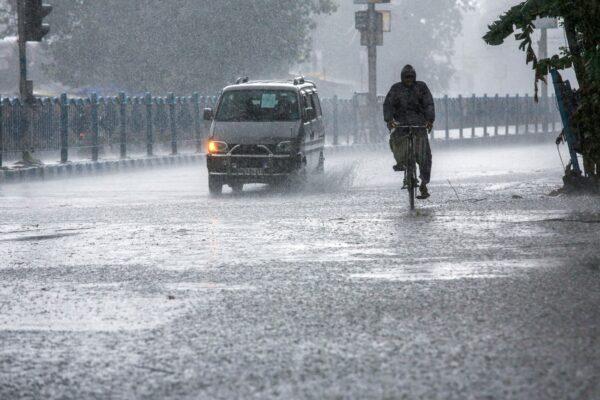 man-pedals-through-rain