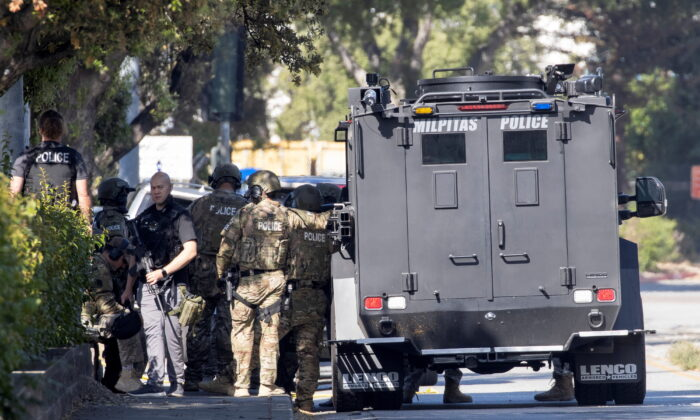 Police secure the scene of a mass shooting at a rail yard run by the Santa Clara Valley Transportation Authority in San Jose, Calif., on May 26, 2021. (Peter DaSilva/Reuters)