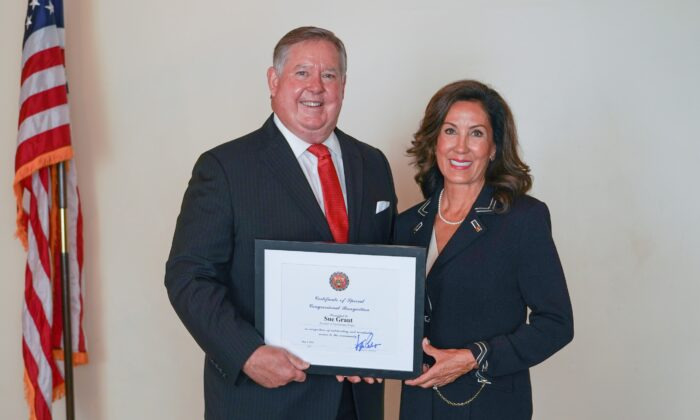 Rep. Ken Calvert presents a congressional award to  Literacy Project Foundation founder and volunteer CEO Sue Grant. (Courtesy of Nepal Arslan)