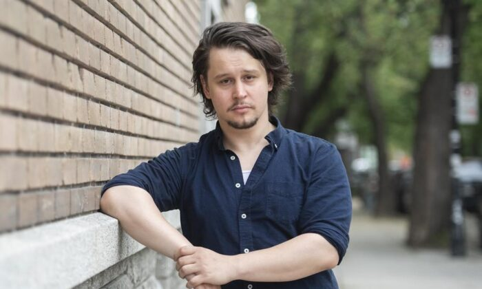 Jonathan Frederic poses near his home in Montreal, on May 22, 2021. (Graham Hughes/The Canadian Press)