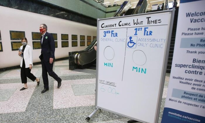 Manitoba Premier Brian Pallister leaves the convention centre after getting a COVID-19 vaccination from Dr. Brent Roussin, chief provincial public health officer, in Winnipeg, on April 8, 2021. (John Woods/The Canadian Press)
