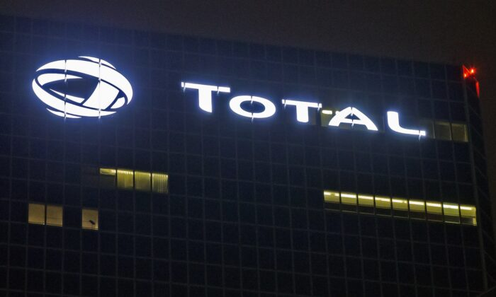 The logo of French oil giant Total at company headquarters in La Defense business district, outside Paris, on Oct. 12, 2016. (Michel Euler/AP Photo)