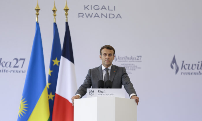 French President Emmanuel Macron speaks after signing the visitor's book at the genocide memorial site in the capital Kigali, Rwanda, on May 27, 2021. (Muhizi Olivier/AP Photo)