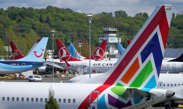 Boeing 737 Max airplanes sit parked in a storage lot near Boeing Field in Seattle, Wash., on April 26, 2021. (Ted S. Warren/AP Photo)