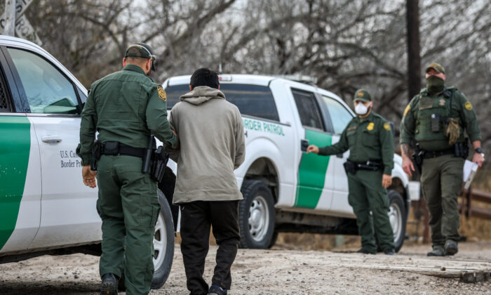 Border Patrol agents apprehend an illegal immigrant in Penitas, Texas, on March 11. 2021. (Charlotte Cuthbertson/The Epoch Times)