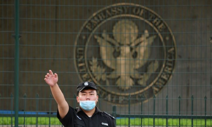A Chinese security guard gestures outside the U.S. embassy in Beijing, China, on Sept. 12, 2020. (Greg Baker/AFP via Getty Images)