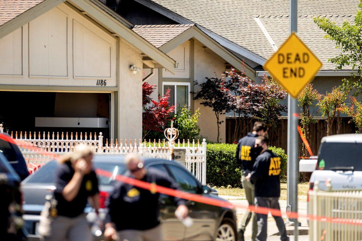 FBI agents approach a home