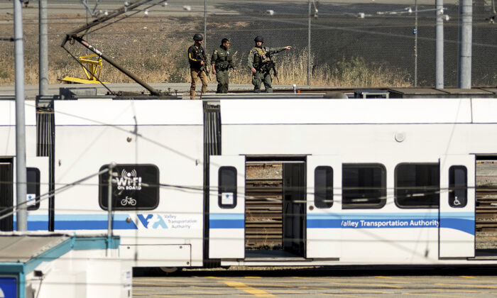 Law enforcement officers respond to the scene of a shooting at a Santa Clara Valley Transportation Authority (VTA) facility in San Jose, Calif., on May 26, 2021. (Noah Berger/AP Photo)