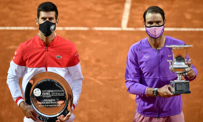 Serbia's Novak Djokovic (L), holding the finalist's trophy and Spain's Rafael Nadal, holding the winner's trophy, pose after the final of the Men's Italian Tennis Open at Foro Italico in Rome, Italy, on May 16, 2021. (Filippo Monteforte/AFP via Getty Images)