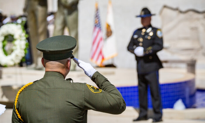 Orange County Peace Officers attend an annual service honoring fallen officers in Tustin, Calif., on May 27, 2021. (John Fredricks/The Epoch Times)