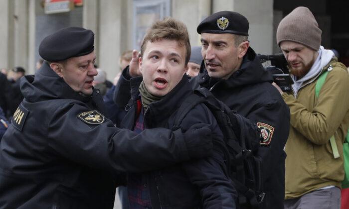 Police detain journalist Roman Pratasevich in Minsk, Belarus, on March 26, 2017. (Sergei Grits/AP Photo)