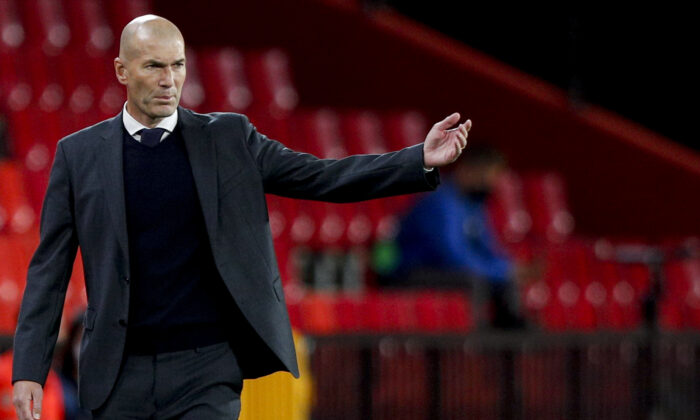 Real Madrid's head coach Zinedine Zidane gestures during the Spanish La Liga soccer match against Granada at Los Carmenes stadium in Granada, Spain, on May 13, 2021. (Fermin Rodriguez/AP Photo)