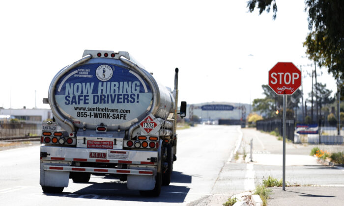 A now hiring advertisement appears on the back of a fuel trucks in Richmond, Calif., on April 29, 2021. (Justin Sullivan/Getty Images)
