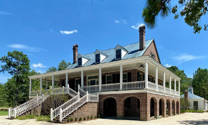 The raised first floor is emblematic of traditional Lowcountry design, in this house in Tillman, South Carolina. (Courtesy of Cronk Duch Architecture)