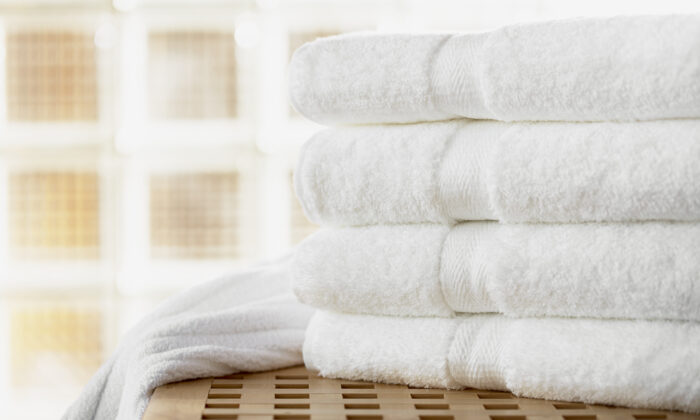 You probably need more fluffy, white bath towels. (Corbis RF Stills)