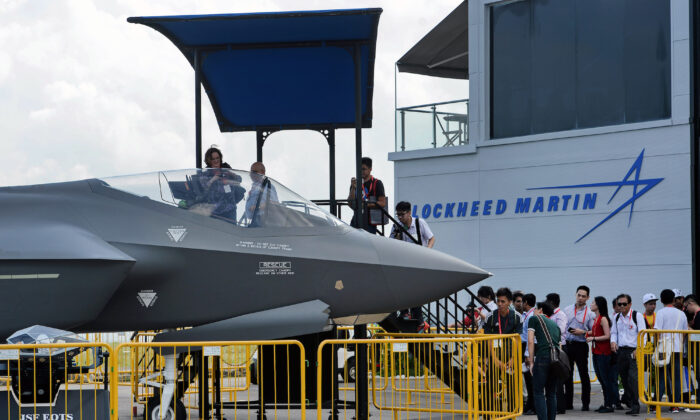 Visitors queue to have closer look at a static display of a Lockheed Martin F-35 at the Singapore Airshow in Singapore on Feb. 18, 2016.  (Roslan Rahman/AFP via Getty Images)
