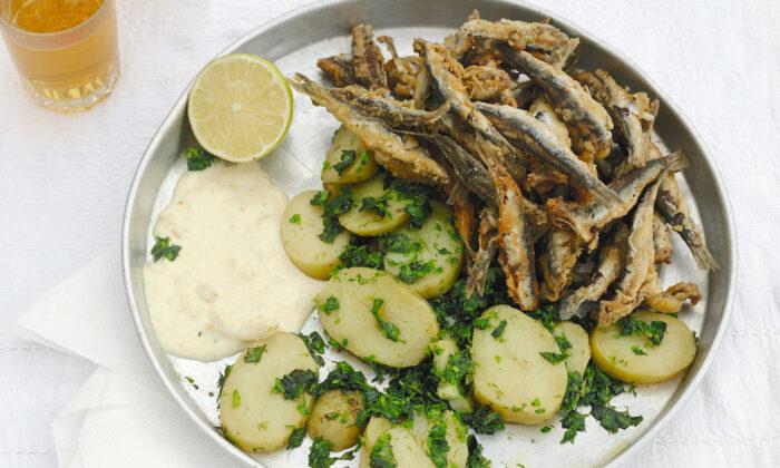 Fried anchovies with potatoes, chopped herbs, and lemon mayonnaise. (Elena Heatherwick)