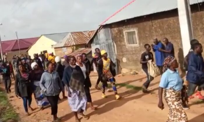 Villagers of Dong flee terrorists in Dong, Nigeria on May 24, 2021. Three slow-moving senior citizens were reported killed. (Screenshot of video by Lawrence Zongo/The Epoch Times)