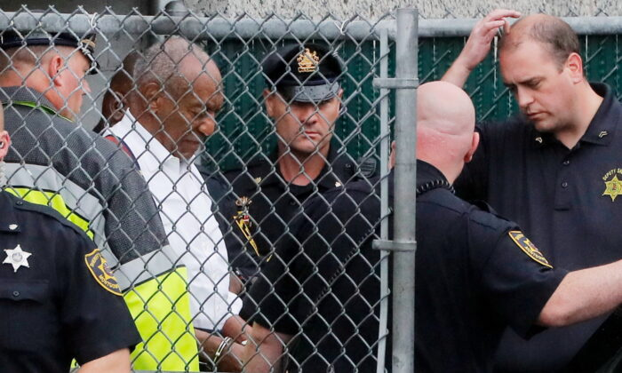 Actor and comedian Bill Cosby leaves the Montgomery County Courthouse in handcuffs after sentencing in his sexual assault trial in Norristown, Pennsylvania, on Sept. 25, 2018. (Brendan McDermid/Reuters)